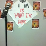 "Poster for the ""Who I Am Is What I've Done"" poetry slam."