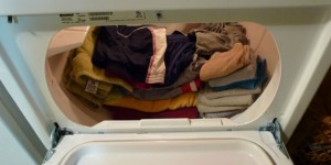 Disproving the Law of Infinite Probability with clothes folded neatly after tumbling dry