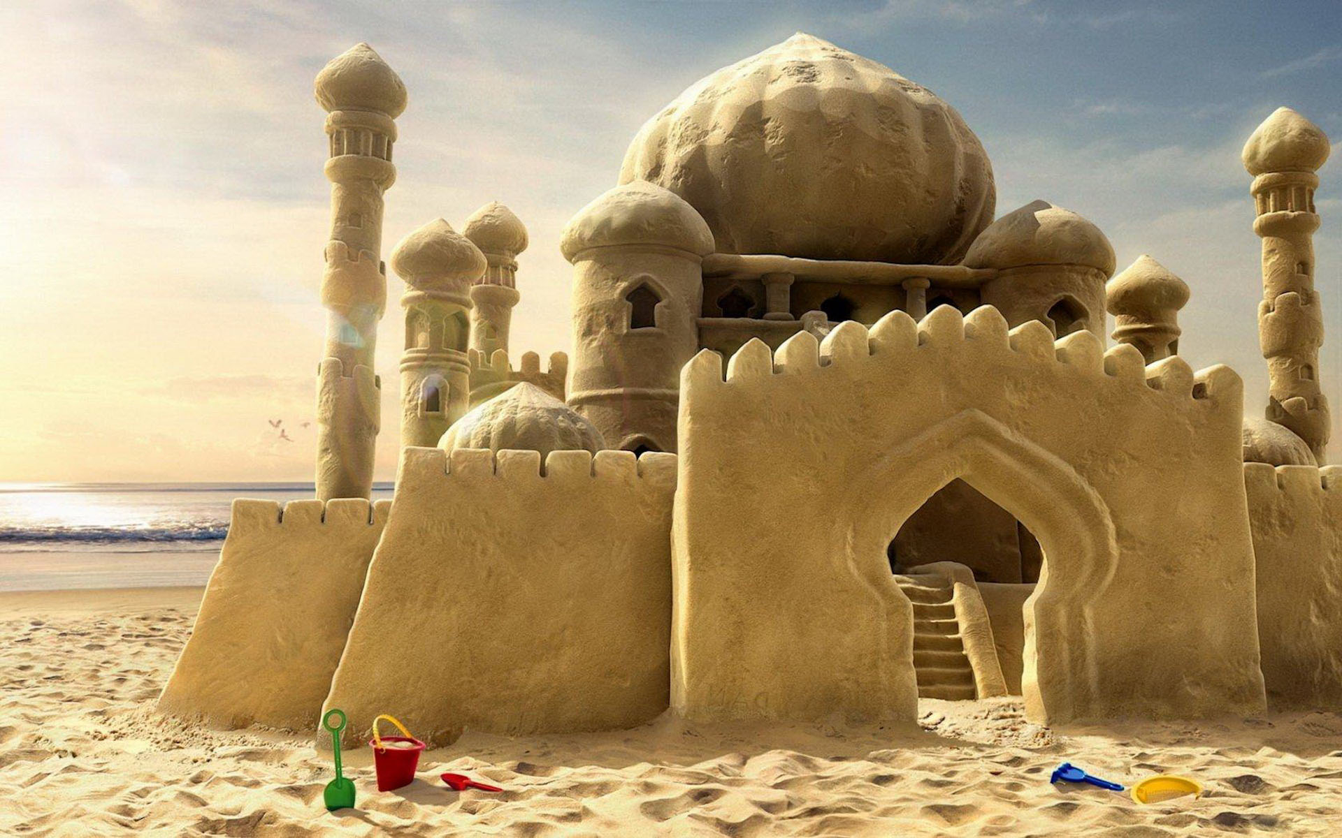 Life-size sandcastle with ornate, designed with middle-eastern type architecture.