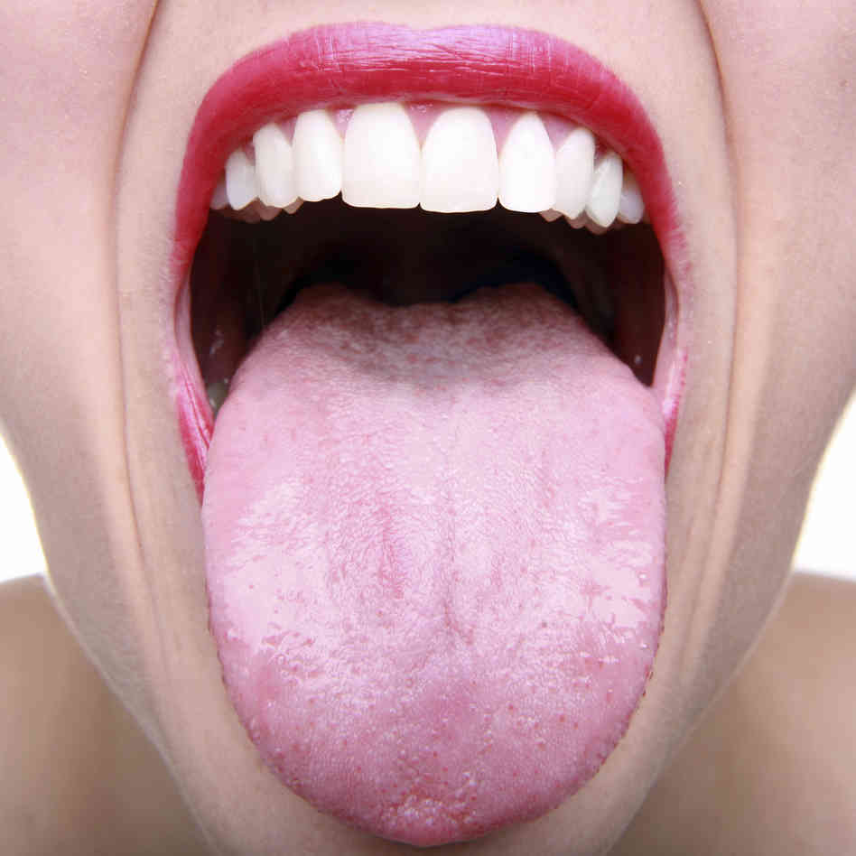 photo of closeup of someone sticking their tongue out