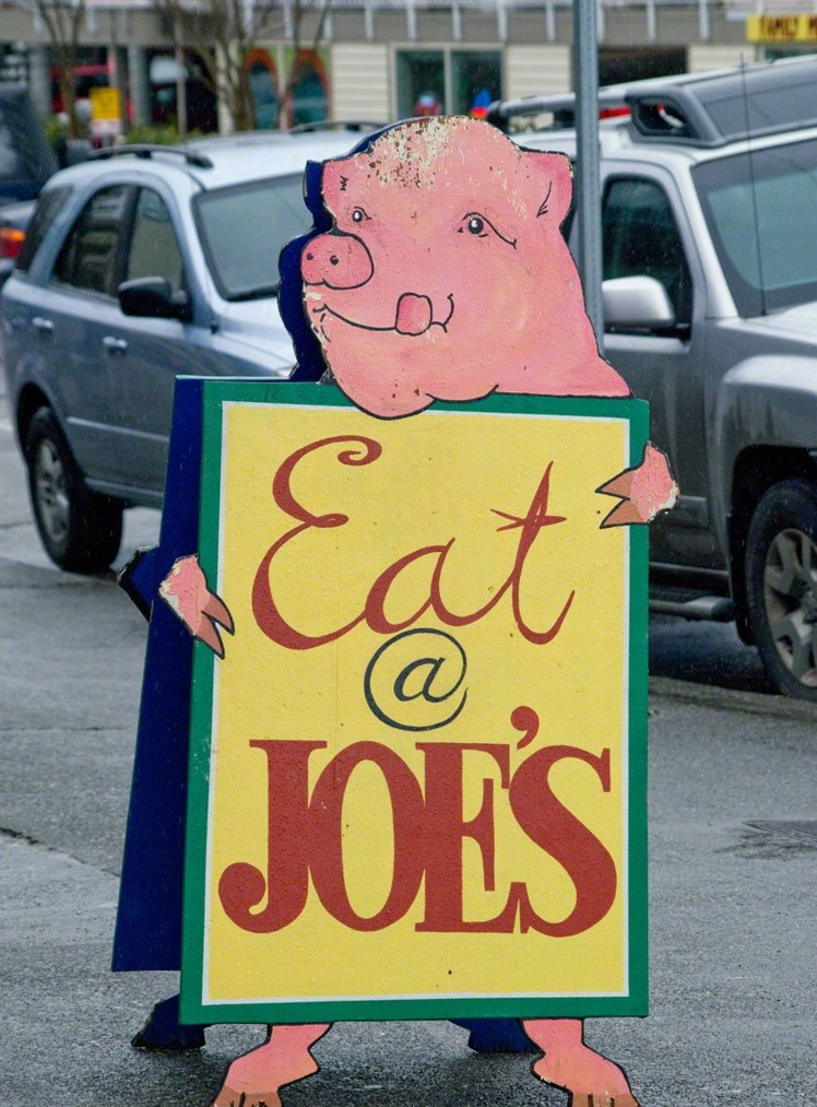 "photo of sidewalk marquee to ""Eat at Joe's"""