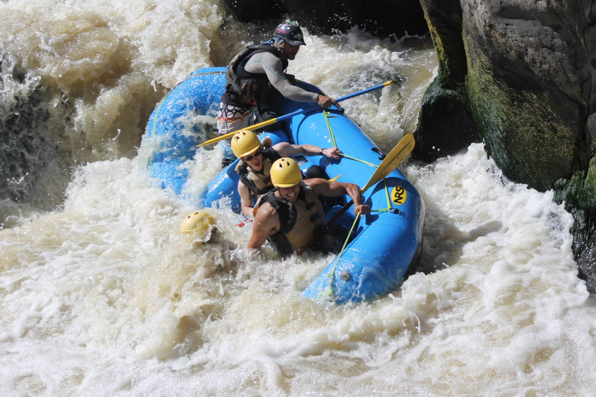 photo of people white water rafting