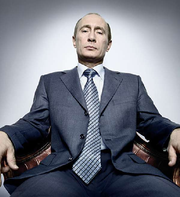 photograph of Putin sitting in a chair