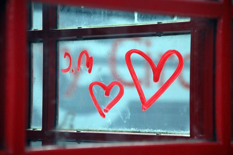 image of red hearts drawn in a window