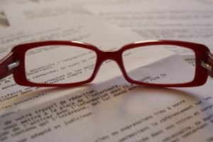 eyeglasses on papers