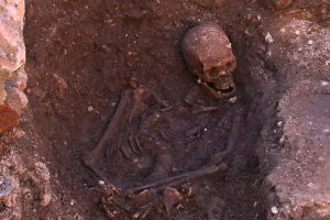 photo of human skeleton in dirt